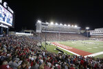 FILE - In this Sept. 21, 2019, file photo, fans watch the first half of an NCAA college football game between Washington State and UCLA at Martin Stadium in Pullman, Wash. While professional sports leagues can ponder plans to isolate their athletes from the coronavirus and have them play in unusual, even secluded places, college sports have no such option. Pro sports leagues can get creative with solutions to save their multibillion-dollar businesses. College sports will take a slower road back. (AP Photo/Young Kwak, File)