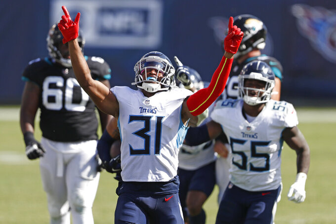 Tennessee Titans free safety Kevin Byard (31) celebrates after teammate Harold Landry intercepted a pass to stop the final drive of the Jacksonville Jaguars in the fourth quarter of an NFL football game Sunday, Sept. 20, 2020, in Nashville, Tenn. The Titans won 33-30.(AP Photo/Wade Payne)