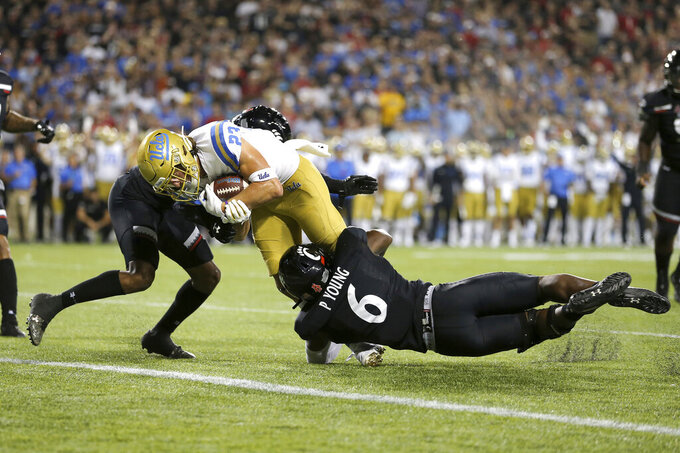UCLA wide receiver Chase Cota (23) scores a touchdown against Cincinnati during the second half of an NCAA college football game Thursday, Aug. 29, 2019, in Cincinnati. (Kareem Elgazzar/The Cincinnati Enquirer via AP)