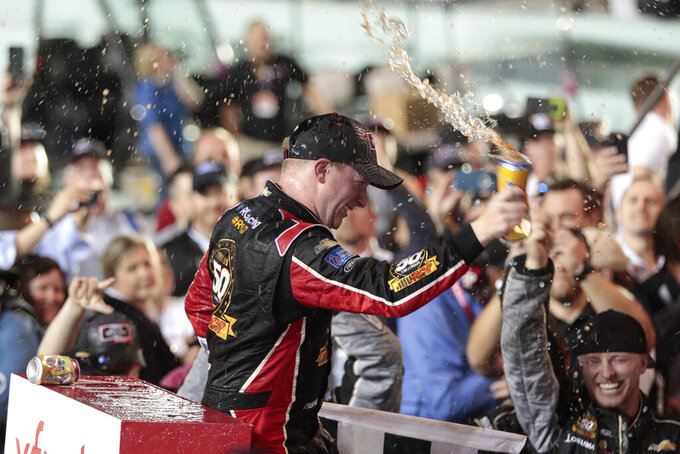 Tyler Reddick celebrates in Victory Lane after winning the NASCAR Xfinity Series auto racing championship at Homestead-Miami Speedway in Homestead, Fla. Saturday, Nov. 16, 2019. (AP Photo/Luis M. Alvarez)
