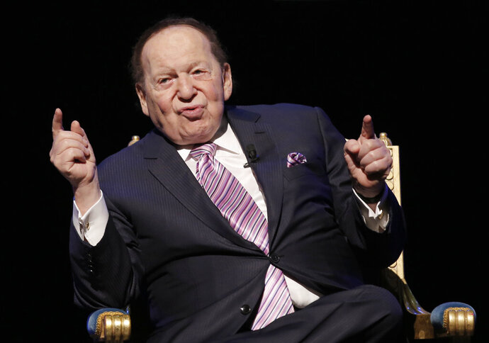 FILE - In this Sept. 13, 2016 file photo, U.S. billionaire Sheldon Adelson speaks during a news conference for the opening of Parisian Macao in Macau.  Adelson, the billionaire mogul and power broker who built a casino empire spanning from Las Vegas to China and became a singular force in domestic and international politics has died after a long illness.  (AP Photo/Kin Cheung, File)