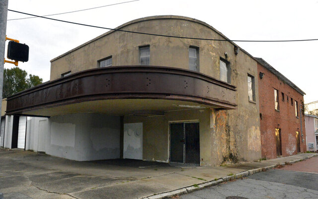 This Jan. 11, 2020 photo shows the Eastside Theater in Savannah, Ga. As the 1950s and '60s found the Eastside Theater hosting the premiere entertainment for black Savannahians on the eastside, the following decades would not be as kind. While during its heyday, the theater would see matinee movies, live performances and 15-cent popcorn, the next decades would see the decay of the roof, the isolation of the property and the disappearance of its community purpose for the neighborhood. (Steve Bisson/Savannah Morning News via AP)