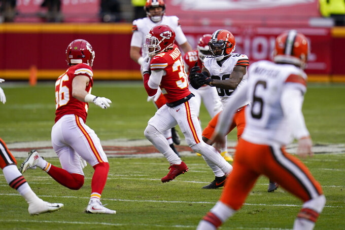 Kansas City Chiefs safety Tyrann Mathieu, center, intercepts a pass during the second half of an NFL divisional round football game against the Cleveland Browns, Sunday, Jan. 17, 2021, in Kansas City. (AP Photo/Jeff Roberson)