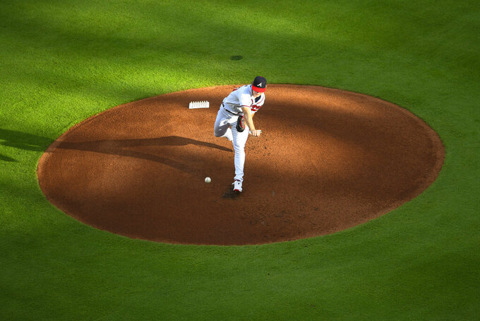 Atlanta Braves' Mike Soroka throws a pitch during the first inning of the home-opening baseball game against the Tampa Bay Rays, Wednesday, July 29, 2020 in Atlanta. (AP Photo/John Amis)