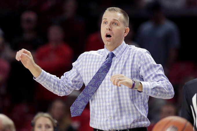 Holy Cross head coach Brett Nelson looks on during the first half of an NCAA college basketball game against Maryland, Tuesday, Nov. 5, 2019, in College Park, Md. (AP Photo/Julio Cortez)