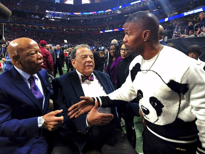 U.S. Rep. John Lewis, D-Ga., left, former U.N. Ambassador Andrew Young and entertainer Jamie Foxx, right, speak on the sidelines before the NFL Super Bowl 53 football game between the Los Angeles Rams and the New England Patriots, Sunday, Feb. 3, 2019, in Atlanta. The Patriots won 13-3. (AP Photo/Jonathan Landrum Jr)