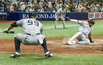 New York Yankees' Aaron Judge (99) watches as Greg Allen, right, scores on a DJ LeMahieu's RBI single off Tampa Bay Rays starter Shane McClanahan during the fifth inning of a baseball game Tuesday, July 27, 2021, in St. Petersburg, Fla. (AP Photo/Steve Nesius)