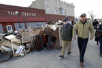 2020 Democratic presidential candidate Washington Gov. Jay Inslee, right, walks with climate analyst John Davis, of Hamburg, Iowa, while touring flood damage, Friday, April 12, 2019, in Hamburg, Iowa. (AP Photo/Charlie Neibergall)