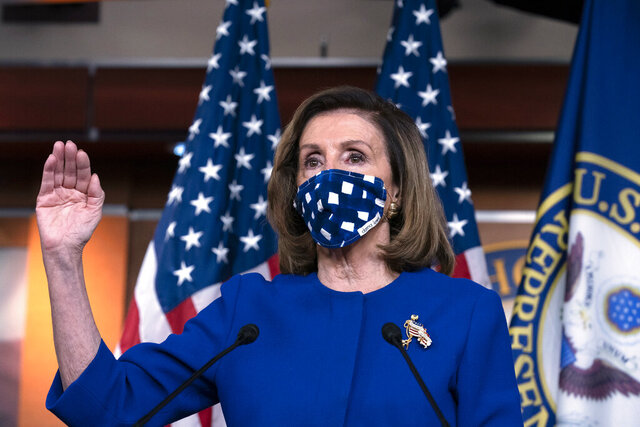 In this Oct. 22, 2020, photo, House Speaker Nancy Pelosi, D-Calif. speaks during a news conference on Capitol Hill, in Washington. In Election 2020, control of the House is not in dispute and Speaker Nancy Pelosi is expanding her reach by working to fortify Joe Biden and win extra seats in case Congress is called on to resolve any Electoral College dispute. (AP Photo/Jose Luis Magana)