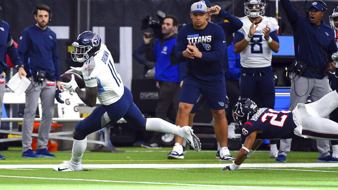 Tennessee Titans wide receiver A.J. Brown (11) breaks away from Houston Texans cornerback Vernon III Hargreaves (28) to score a touchdown after catching a pass during the first half of an NFL football game Sunday, Dec. 29, 2019, in Houston. (AP Photo/Eric Christian Smith)