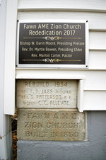 This December 2017 photo shows a new plaque, top, which was mounted in 2017 commemorating the rededication of Fawn AME Zion Church after major construction was completed, in New Park, Pa. Below it is a cornerstone placed in 1954 when the current church was built and below that a cornerstone from 1850 when the log church was built.  (Paul Kuehnel/York Daily Record via AP)