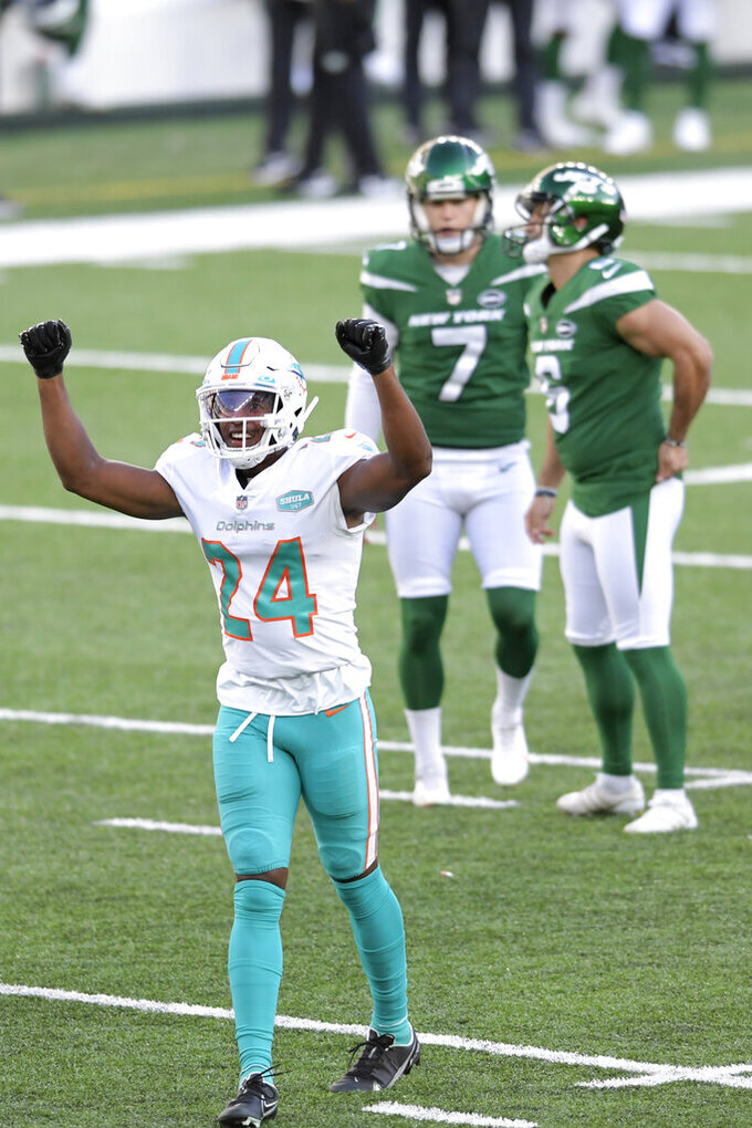 Miami Dolphins' Byron Jones (24) reacts after New York Jets' kicker Sergio Castillo, back right, missed a field goal during the first half of an NFL football game, Sunday, Nov. 29, 2020, in East Rutherford, N.J. (AP Photo/Bill Kostroun)