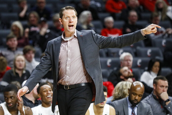 Cincinnati Bearcats head coach John Brannen directs his players from the bench during the second half of an NCAA college basketball game against East Carolina, Sunday, Jan. 19, 2020, in Cincinnati. (AP Photo/John Minchillo)