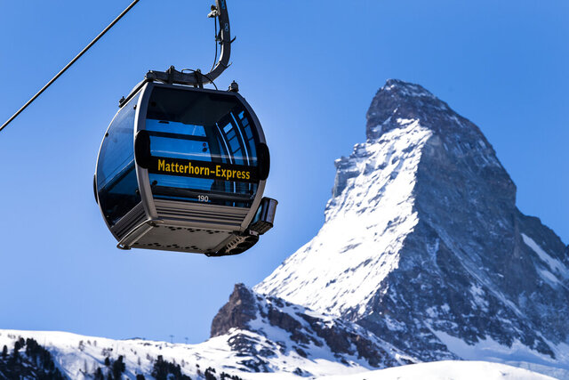 The 'Matterhorn-Express' gondola lift is pictured in front of Matterhorn mountain in the ski resort Zermatt, Switzerland, Wednesday, March 18, 2020. On March 16 the Swiss authorities proclaimed a state of emergency until April 19, 2020 in an effort to halt the spread of the coronavirus and Covid-19 disease. For most people, the new coronavirus causes only mild or moderate symptoms, such as fever and cough. For some, especially older adults and people with existing health problems, it can cause more severe illness, including pneumonia. (Jean-Christophe Bott/Keystone via AP)