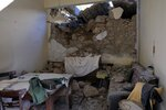 A damaged house is seen after an earthquake in Sampas village on the southern island of Crete, Greece, Monday, Sept. 27, 2021. A strong earthquake has struck the Greek island of Crete. One person has been killed and at least nine others have been injured. Homes and churches were damaged and rock slides occurred near the country's fourth-largest city. (AP Photo/Harry Nakos)