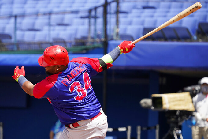 Dominican Republic's Juan Francisco (34) strikes out during a baseball game against the United States at the 2020 Summer Olympics, Wednesday, Aug. 4, 2021, in Yokohama, Japan. (AP Photo/Sue Ogrocki)