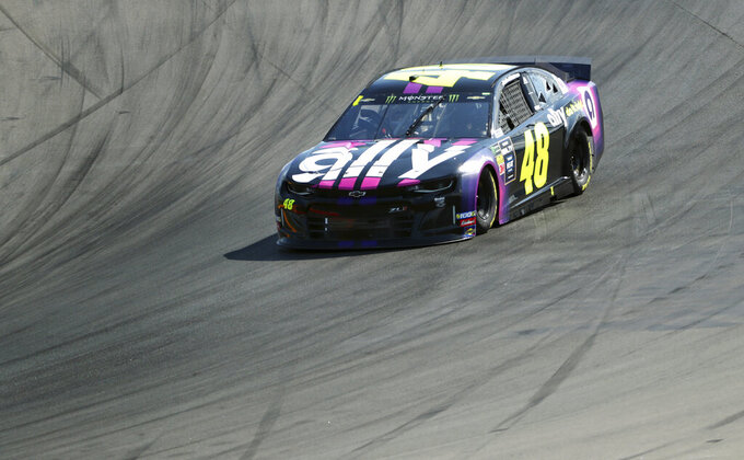Jimmie Johnson heads into Turn 1 during a NASCAR Cup Series auto race at Watkins Glen International, Sunday, Aug. 4, 2019, in Watkins Glen, N.Y. (AP Photo/John Munson)