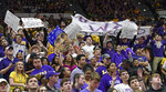 The LSU student section waves signs and banners supporting embattled LSU head coach Will Wade in the first half of an NCAA college basketball game, Saturday, March 9, 2019, in Baton Rouge, La. (AP Photo/Bill Feig)