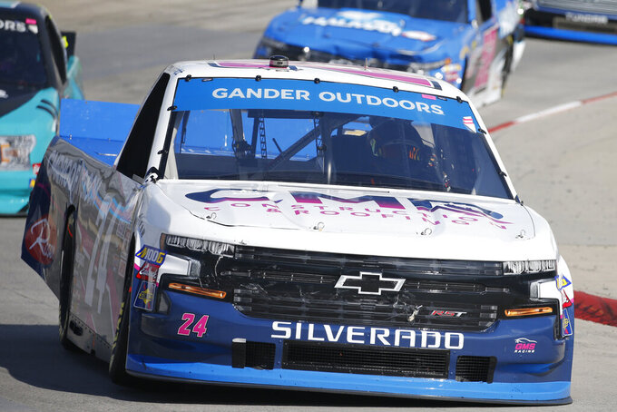 Brett Moffitt (24) makes the turn in turn four during the NASCAR Truck Series race at Martinsville Speedway in Martinsville, Va., Saturday, Oct. 26, 2019, (AP Photo/Steve Helber)