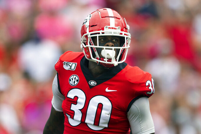 FILE - In this Sept. 14, 2019, file photo, Georgia linebacker Tae Crowder looks over the offensive lineup of Arkansas State during an NCAA football game in Athens, Ga. Crowder is going to have to settle for being Mr. Irrelevant without the frills for now. Still, the Georgia linebacker is just happy being picked by the New York Giants in the NFL draft. (AP Photo/John Amis, File)