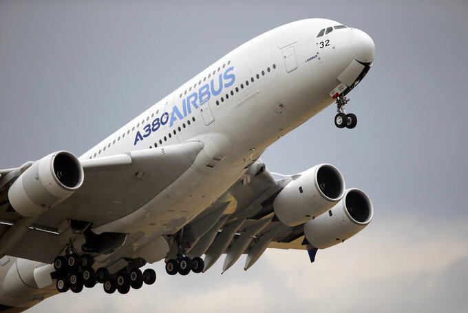 FILE - In this June 18, 2015, file photo, an Airbus A380 takes off for its demonstration flight at the Paris Air Show in Le Bourget airport, north of Paris. European planemaker Airbus reports that it made 1.87 billion euros profit in the second quarter. That's a relief after a loss in the same quarter a year ago during the depths of the pandemic shutdowns and travel restrictions. (AP Photo/Francois Mori, File)