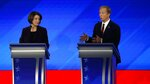 Democratic presidential candidate businessman Tom Steyer, right, makes a point as Sen. Amy Klobuchar, D-Minn., left, listens during a Democratic presidential primary debate, Friday, Feb. 7, 2020, hosted by ABC News, Apple News, and WMUR-TV at Saint Anselm College in Manchester, N.H. (AP Photo/Elise Amendola)