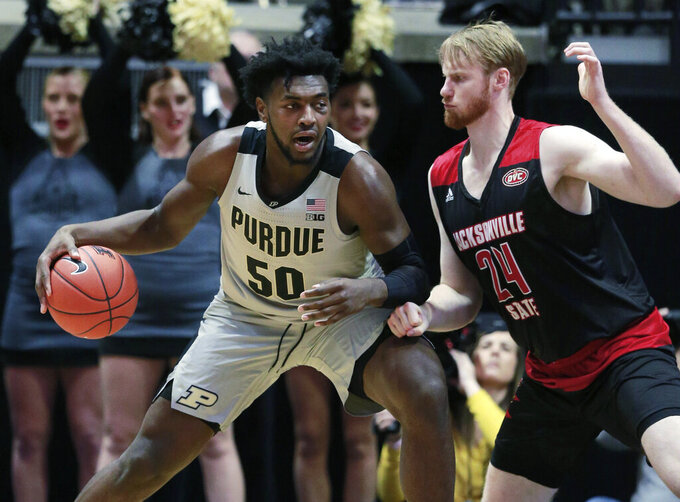 Purdue forward Trevion Williams (50) drives to the basket defended by Jacksonville State forward Martin Roub during an NCAA college basketball game Saturday, Nov. 23, 2019, in West Lafayette, Ind. (AP Photo/R Brent Smith)