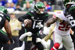 New York Jets quarterback Sam Darnold (14) looks to pass as New York Giants' Markus Golden (44) attempts to sack him during the first half of an NFL football game Sunday, Nov. 10, 2019, in East Rutherford, N.J. Darnold completed a first down on the play. (AP Photo/Steven Ryan)
