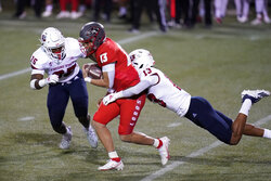 Fresno State linebacker Justin Houston (13) tackles New Mexico quarterback Isaiah Chavez during the first half of an NCAA college football game Saturday, Dec. 12, 2020, in Las Vegas. (AP Photo/John Locher)