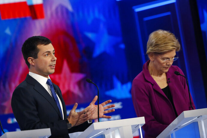 Democratic presidential candidate South Bend, Ind., Mayor Pete Buttigieg, left, speaks as Democratic presidential candidate Sen. Elizabeth Warren, D-Mass., listens, during a Democratic presidential primary debate, Wednesday, Nov. 20, 2019, in Atlanta. (AP Photo/John Bazemore)