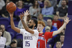 Washington guard Marcus Tsohonis (15) passes the  ball away from Arizona guard Nico Mannion during the first half of an NCAA college basketball game Thursday, Jan. 30, 2020, in Seattle. (AP Photo/Ted S. Warren)