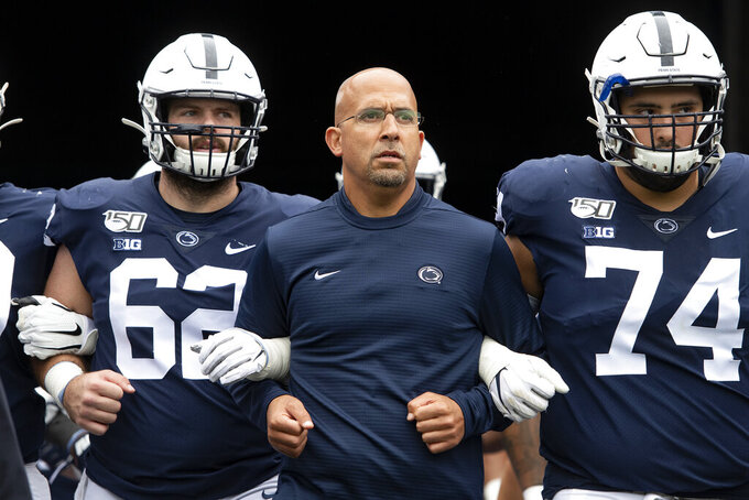FILE - In this Saturday, Sept. 14, 2019 file photo, Penn State head coach James Franklin leads his team onto the field for an NCAA college football game against Pittsburgh in State College, Pa. The Indiana Hoosiers took some big steps in rebranding their football program last season. Now they're looking to build on the momentum. Penn State coach James Franklin and others around the league have watched Indiana's steady progression. They believe a cadre of offensive playmakers coupled with an experienced defense could put Indiana on the cusp of a breakthrough.(AP Photo/Barry Reeger, File)