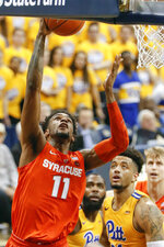 Syracuse's Oshae Brissett (11) shoots after getting by Pittsburgh's Terrell Brown, right, and Jared Wilson-Frame, center, during the second half of an NCAA college basketball game, Saturday, Feb. 2, 2019, in Pittsburgh. Syracuse won 65-56. (AP Photo/Keith Srakocic)