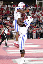 SMU wide receiver James Proche (3) is picked up by offensive lineman Cobe Bryant (57) after Proche's touchdown during the first half of an NCAA college football game against Houston on Thursday, Oct. 24, 2019, in Houston. (AP Photo/Michael Wyke)