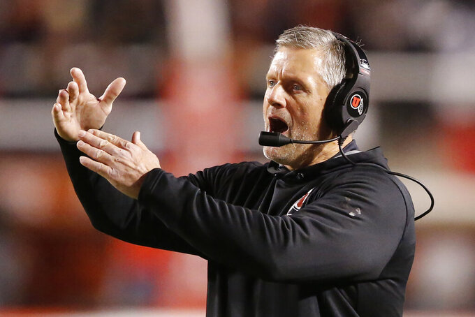 Utah head coach Kyle Whittingham calls a time-out in the first half of an NCAA college football game against California Saturday, Oct. 26, 2019, in Salt Lake City. (AP Photo/Rick Bowmer)