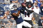 Penn State wide receiver Jahan Dotson (5) battles Ball State safety J.T. Wahee (14) for an incomplete pass during an NCAA college football game in State College, Pa., Saturday, Sept. 11, 2021. (AP Photo/Barry Reeger)