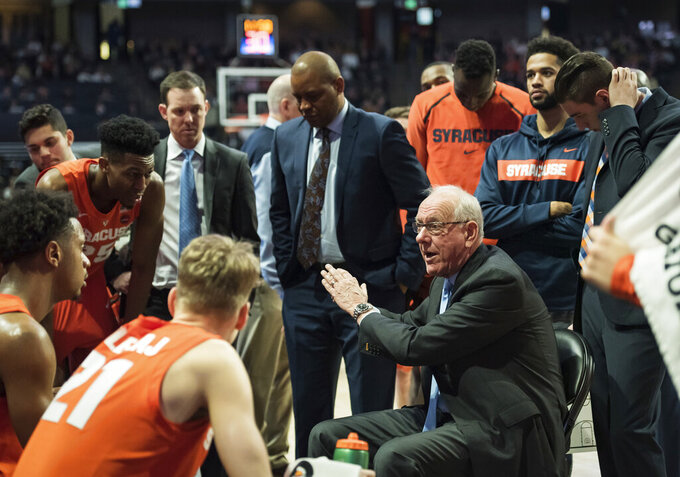Syracuse head coach Jim Boeheim speaks to his team during a timeout against Wake Forest in the second half of an NCAA college basketball game, Saturday, March 2, 2019, at Joel Coliseum in Winston-Salem, N.C. (Allison Lee Isley/The Winston-Salem Journal via AP)
