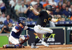 Pittsburgh Pirates' Corey Dickerson (12) hits a two-run single as Houston Astros catcher Robinson Chirinos watches during the third inning of a baseball game Wednesday, June 26, 2019, in Houston. (AP Photo/David J. Phillip)