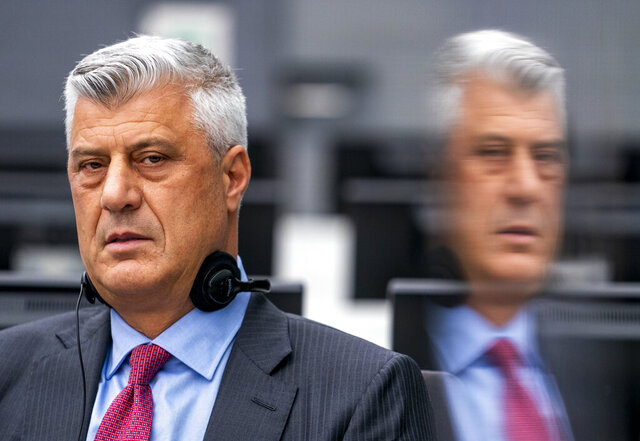 Hashim Thaci, who resigned as Kosovo's president to face charges including murder, torture and persecution, makes his first courtroom appearance before a judge at the Kosovo Specialist Chambers court in The Hague, Netherlands, Monday, Nov. 9, 2020. An international prosecutor has indicted Thaci on 10 charges of crimes against humanity and war crimes for his leadership of fighters with the Kosovo Liberation Army who are accused of illegally imprisoning, abusing and murdering captured opponents and perceived traitors during the war. (AP Photo/Jerry Lampen via AP Photo, Pool)