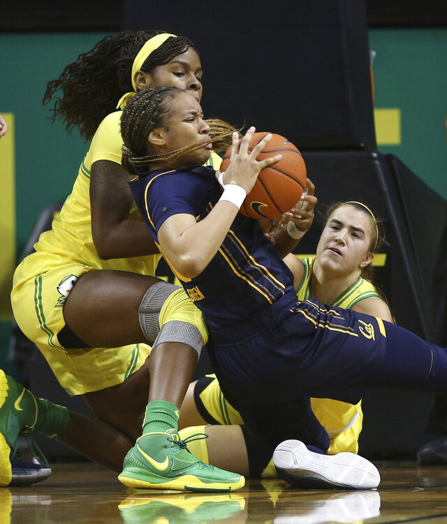 Oregon's Ruthy Hebard, left, and Sabrina Ionescu, right, force a turnover against California's Jazlen Green during the second quarter of an NCAA college basketball game Sunday Jan. 19, 2020 in Eugene, Ore. (Chris Pietsch/The Register-Guard via AP)