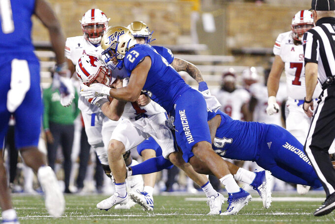 SMU quarterback Shane Buechele (7) is stopped short of a first down by Tulsa linebacker Zaven Collins (23) during the second half of an NCAA college football game in Tulsa, Okla., Saturday, Nov. 14, 2020. (AP Photo/Joey Johnson)
