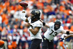 Wake Forest quarterback Jamie Newman throws a pass from the pocket against Syracuse during the first half of an NCAA college football game in Syracuse, N.Y., Saturday, Nov. 30, 2019. (AP Photo/Adrian Kraus)