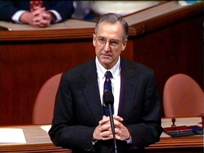 FILE - In this Dec. 19, 1998, file image from video, then-House Speaker nominee Rep. Bob Livingston, R-La., speaks during the House session in Washington, during debate on the four articles of impeachment against President Clinton. Impeachment is back, and so is Livingston. The former congressman who abruptly resigned on the same day the House impeached President Bill Clinton made an improbable return Wednesday, Oct. 30, 2019, as a figure in the sequel — the drive to impeach President Donald Trump. The connection stunned official Washington, home of long memories for scandal, grudges and political payback. (AP Photo/APTN, File)
