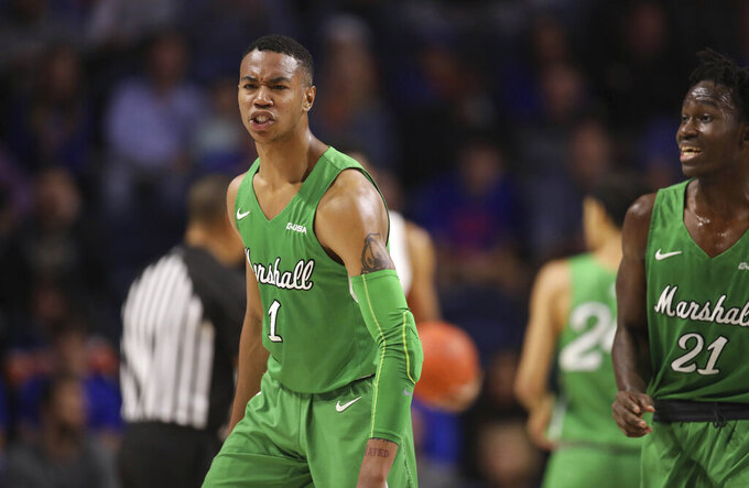 Glover scores 14, No. 24 Florida beats Marshall 73-67