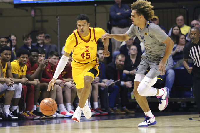 Iowa State guard Rasir Bolton (45) drives up court as he is defended by West Virginia forward Emmitt Matthews Jr. (11) during the second half of an NCAA college basketball game Wednesday, Feb. 5, 2020, in Morgantown, W.Va. (AP Photo/Kathleen Batten)