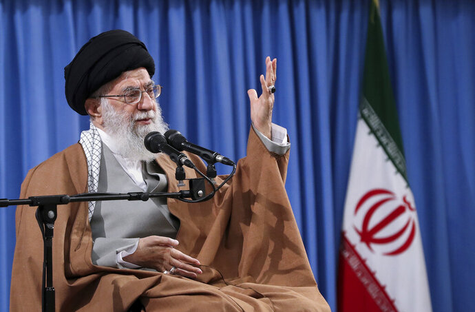 In this picture released by an official website of the office of the Iranian supreme leader, Supreme Leader Ayatollah Ali Khamenei speaks at a meeting with a group of  Revolutionary Guards and their families, in Tehran, Iran, Tuesday, April 9, 2019. Khamenei praised Iran's Revolutionary Guard and said America's