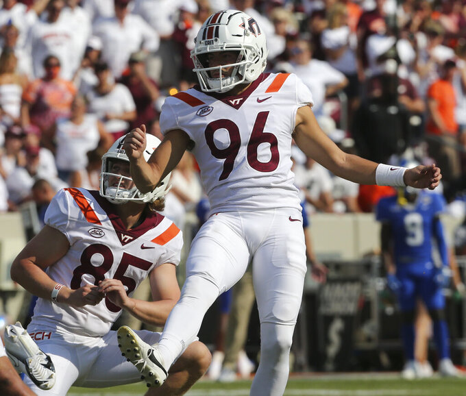 Virginia Tech place kicker John Parker Romo (96) kicks an extra point with holder Peter Moore (85) in the second half of an NCAA college football game against Middle Tennessee, Saturday, Sept. 11, 2021, in Blacksburg Va. (AP Photo/Matt Gentry)