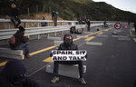 Pro-Catalan independence demonstrators block a major highway border pass between France and Spain near La Jonquera, Girona, Monday, Nov. 11, 2019. Protesters following a call to action by a secretive pro-Catalan independence group have closed off both sides of the AP7 highway at the major transportation hub of La Jonquera between France and Spain. (AP Photo/Felipe Dana)