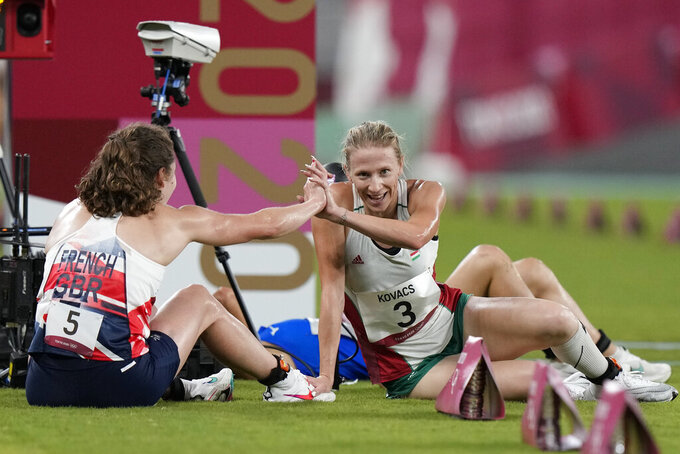 Winner Kate French of Great Britain celebrates with Sarolta Kovacs of Hungary after winning the women's modern pentathlon at the 2020 Summer Olympics, Friday, Aug. 6, 2021, in Tokyo, Japan. (AP Photo/Andrew Medichini)