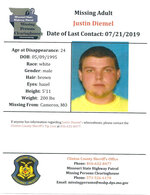 FILE - This document provided by the Clinton County Missouri Sheriff's Department shows a missing poster for Justin Diemel. Justin and his brother Nicholas Diemel, who owned Diemel's Livestock in Bonduel, Wis., have been missing since July 21, 2019, when they were in northwest Missouri to check cattle for their business. Lisa Diemel, the wife of Justin's brother Nicholas Diemel, is asking a judge to oversee the men's business. (Clinton County Missouri Sheriff's Department via AP, File)